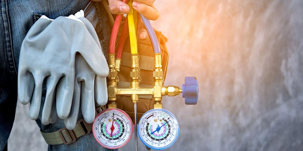 Homeowner prepares tools for furnace maintenance job.