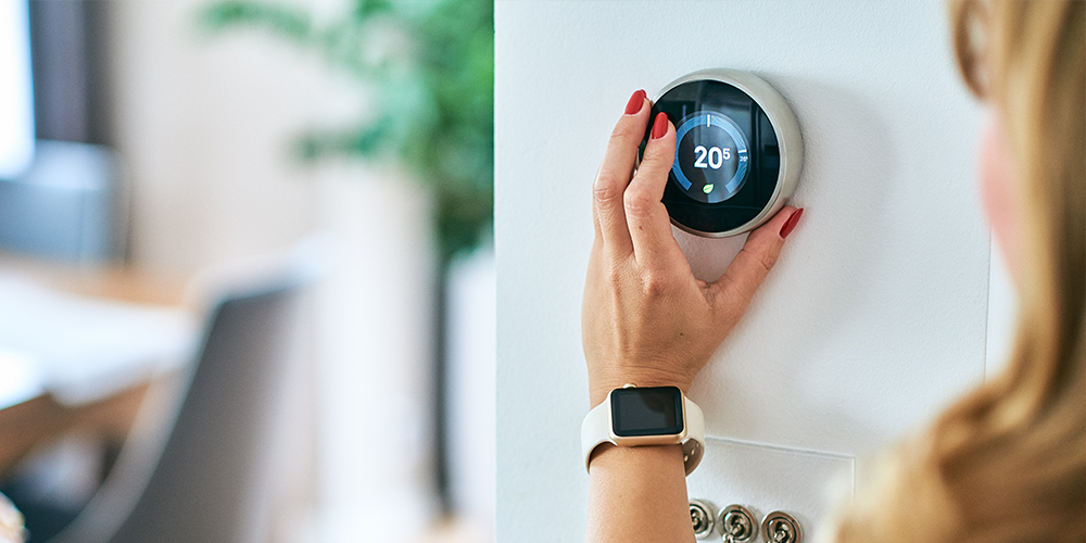 Woman enjoying the benefits of a Wi-Fi thermostat